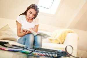 Young Woman On Couch, Drawing In Coloring Book