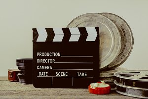 Clapperboard, tin boxes with film