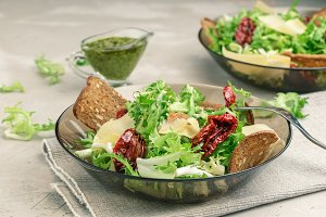 Frisee salad with sun dried tomatoes