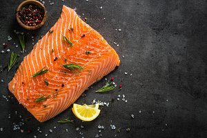 Fresh fish. Salmon fillet on black.