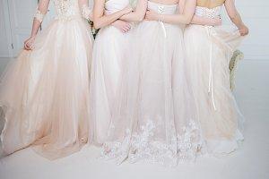 Bride in wedding salon. Four girls