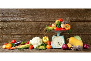 Big composition of fresh autumn vegetables on a wood long banner brown background