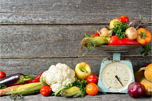 composition raw of fresh autumn vegetables on a wooden brown background
