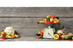 Banner composition of raw organic fresh vegetables, balance on wooden brown table