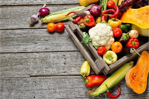 Raw organic set of fresh vegetables in wooded box background. Autumn harvest from the garden