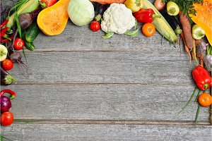 Big set of fresh autumn vegetables on a wood background