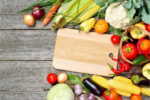 Raw organic set of fresh vegetables on a wood background. Autumn harvest from the garden