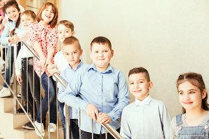 Pupils standing on the stairs