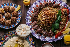 Middle eastern or arabic dishes and assorted meze on a dark background