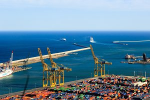 Panoramic view of the cargo port in Barcelona, sunset time, aerial view