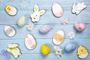 Easter background. Cookies in shape of Easter eggs and Easter bunny.