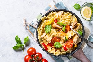 Pasta with chicken and vegetables top view.