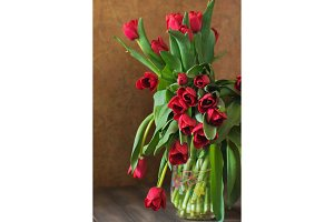 Still life with tulips bouquet on wooden table