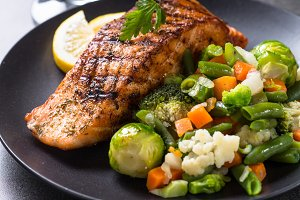 Grilled salmon fillet with vegetables mix.