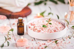 Essential oil for aromatherapy, flowers, handmade soap, himalayan salt.