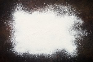 Flour on dark background.