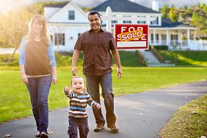 Family in Front of House, Sold Sign