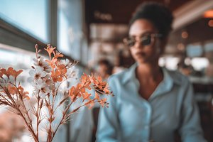 Black girl and artificial flowers