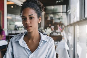 Portrait of black girl in cafe