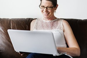 White woman using laptop