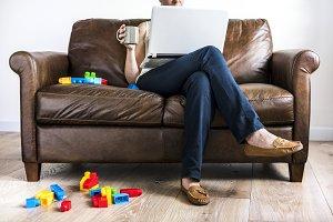 White woman using laptop at sofa