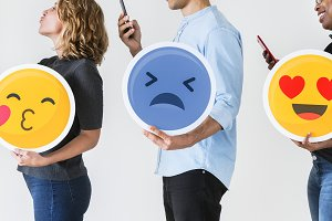 People holding emoticons