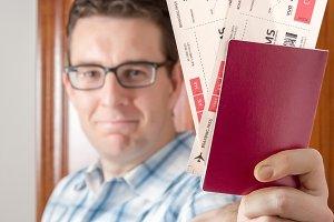 Man show boarding pass and passport
