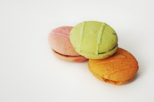 Three macaroons on table