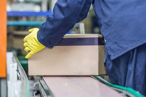 Worker lifting box.