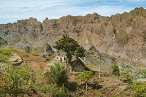 Hiker makes landscape shots of agriculture terraces, monumental mountain peaks and vast green valleys. Corda Coculli Santo Antao Cape Verde