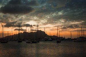 Colorful dawn over Monte Cara mountain in hardor of Mindelo. Sao Vicente Cape Verde
