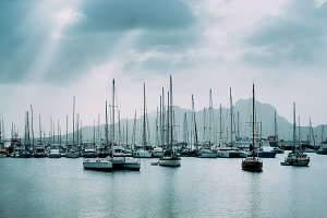 Sailboats and pleasure boats in the porto grande bay of the historic city Mindelo. Clodscape with Sunrays