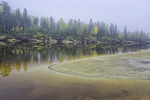 Yugra, a misty morning on the bank of the taiga river