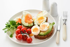 Egg and avocado toasts on white