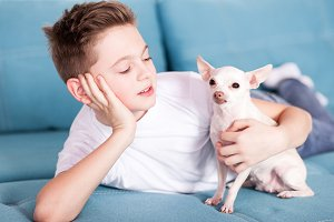 Teen boy with pet