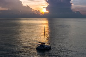 Dawn over sailing boat.