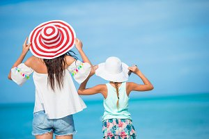 Beautiful mother and daughter on Caribbean beach. Family beach vacation
