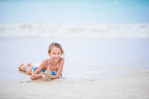 Adorable little girl on the beach during summer vacation