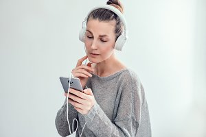 Stylish, young woman in headphones