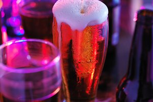beer at bar in colorful light