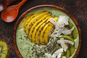 Green kale vegan smoothie bowl
