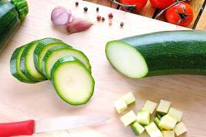 Green zucchini on cutting board