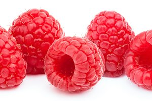 Five ripe raspberries isolated
