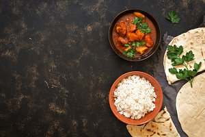 Indian dish Chicken Tikka masala with rice. Top view, copy space.