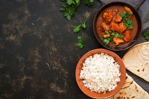 Traditional Indian dish chicken Tikka masala. Top view, copy space.
