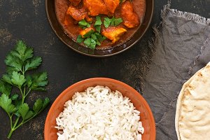 Chicken Tikka masala with rice in the bowl. Indian food. Top view, copy space.