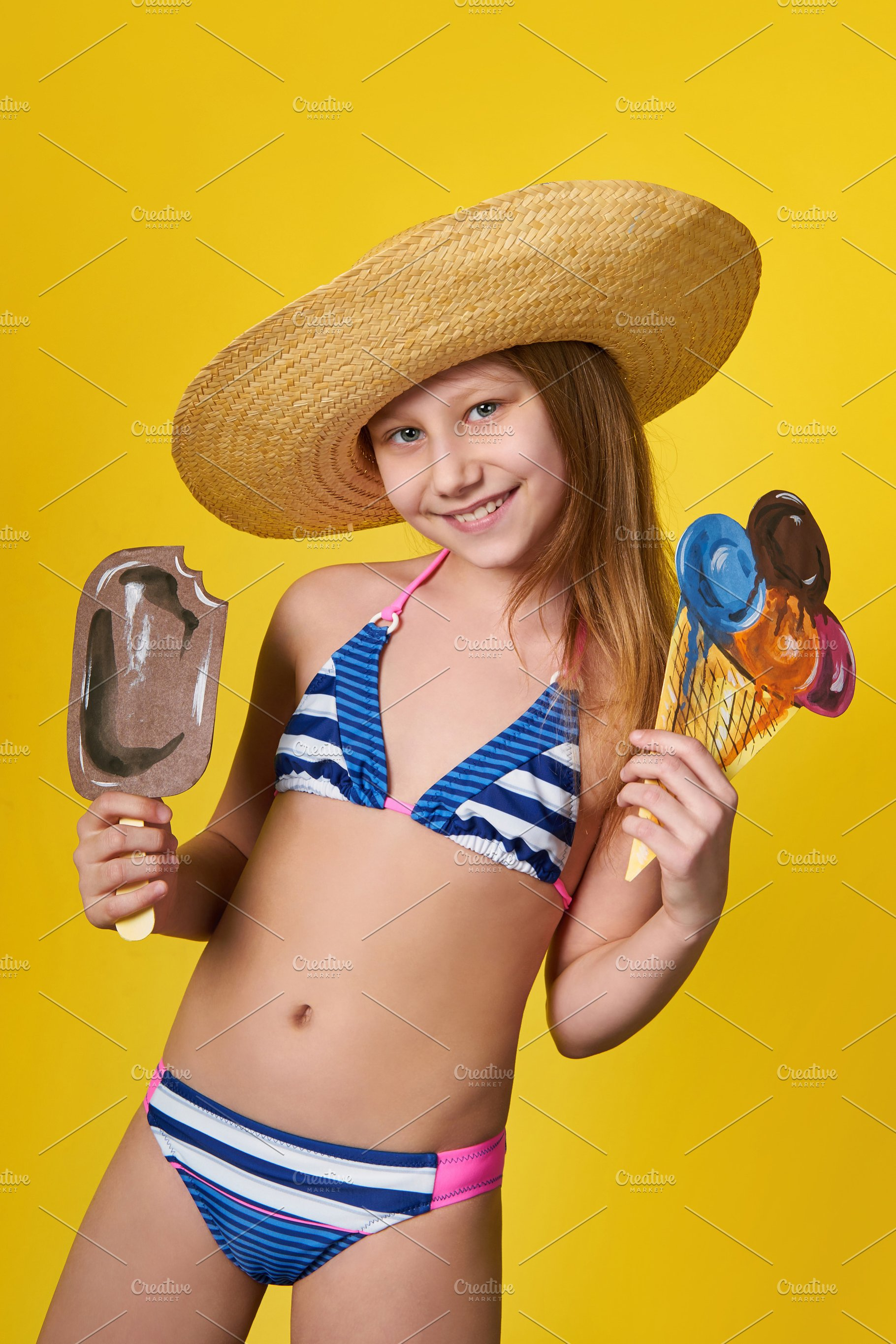 d36cb9df6e Cute girl wearing swimsuit holds in hand image ice cream. Cheerful ...