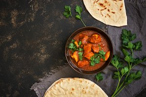 Hot spicy chicken tikka masala in bowl.A popular Indian spicy dish. Top view, close-up.