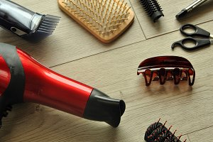 hairdressing tools on a wooden floor