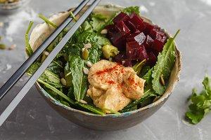Vegan beet, hummus salad